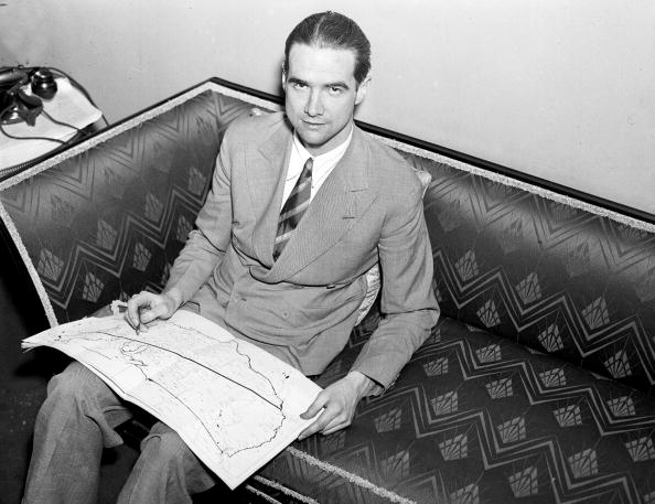 UNITED STATES - JANUARY 14:  Howard Hughes relaxes after he spanned the U.S. in 9 1/2 hours, whizzing 260 miles-an-hour from Burbank, Calif., to Newark, N.J,, and setting a new cross-country record.  (Photo by NY Daily News Archive via Getty Images)